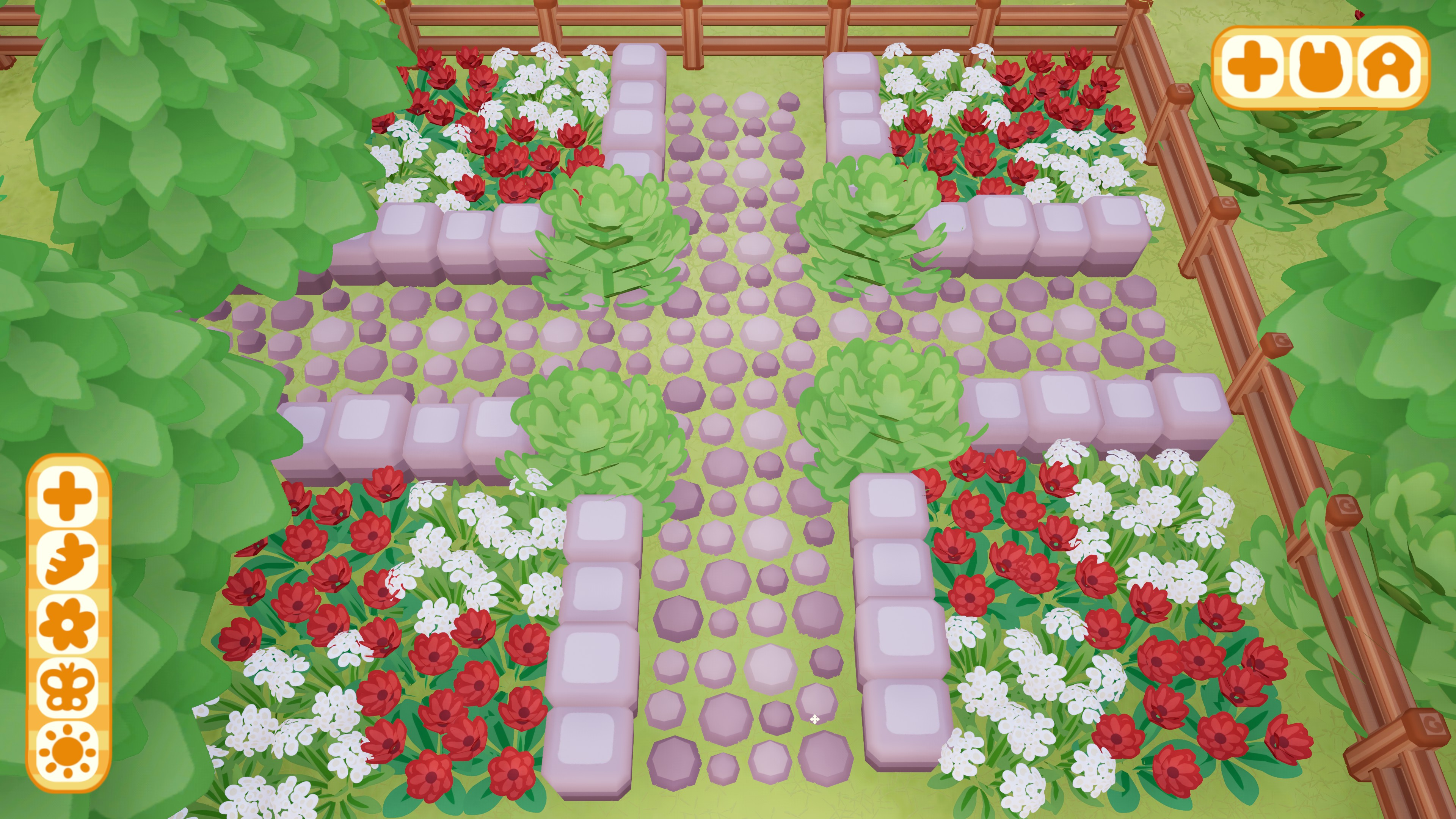 Bunny Park. A dense garden of red and white flowers with stone paths and walls